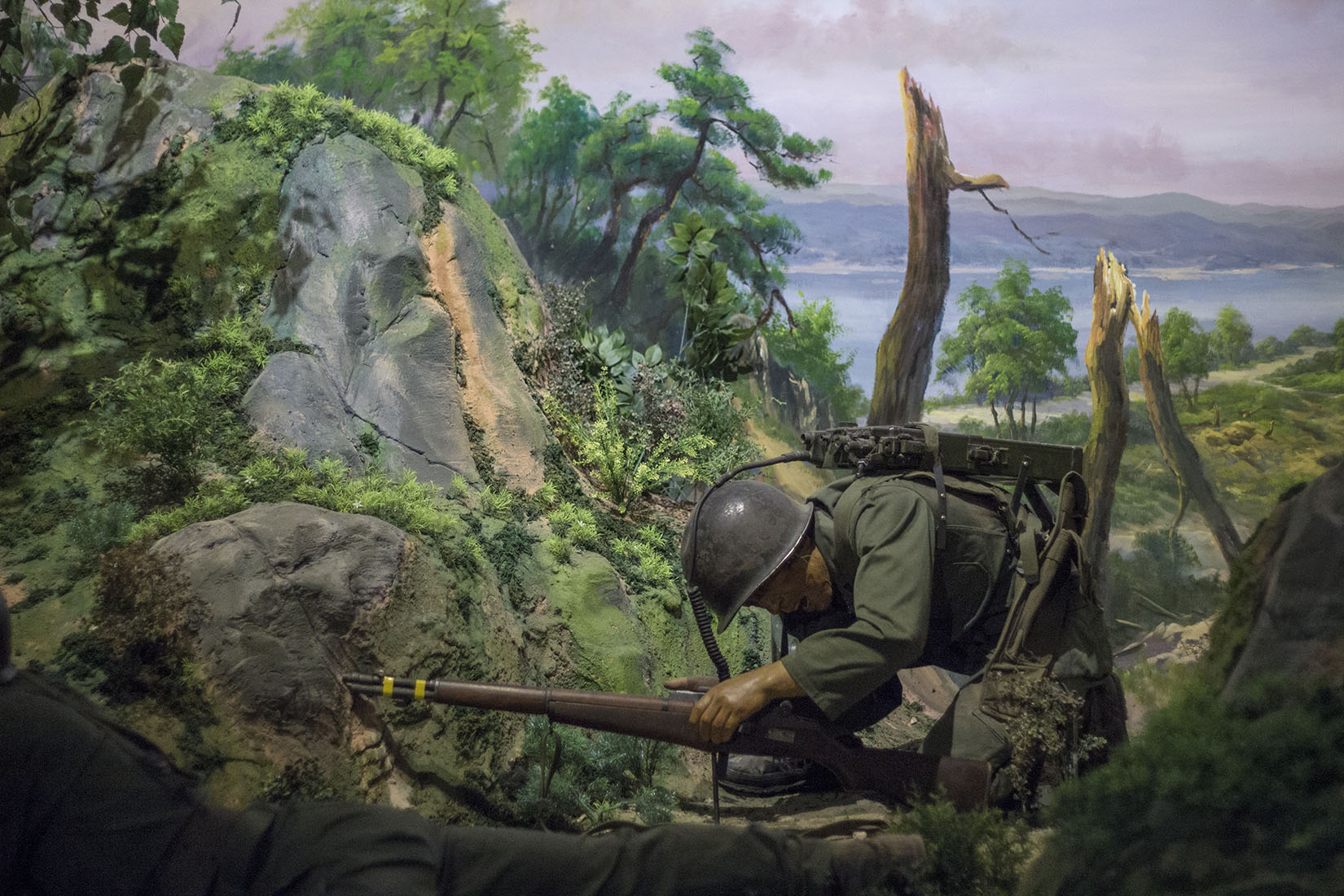 South Korean soldier suffering, rifle, landscape, painting, wax mannequin, Seoul, photography