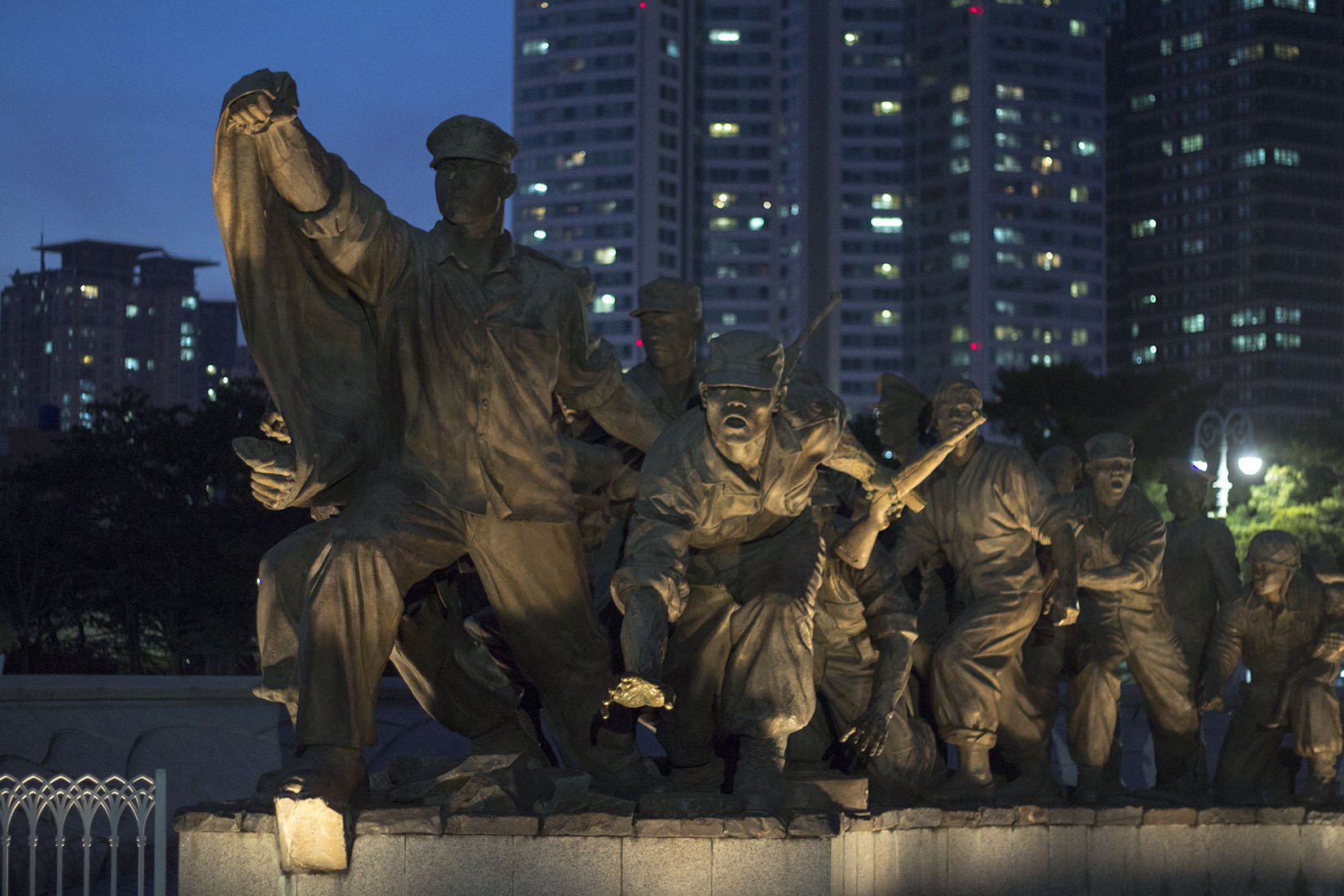 Seoul, bronze soldiers statue, South Korean flag, night, buildings, war