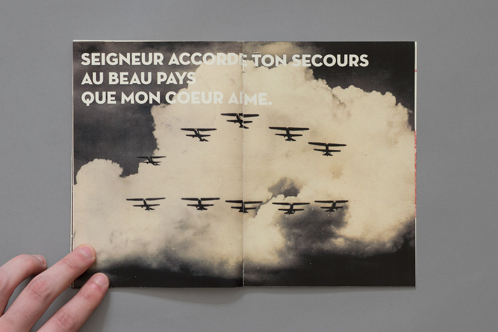 Manual for the perfect little soldier, military aircraft, clouds, Seigneur accorde ton secours au beau pays que mon coeur aime.
